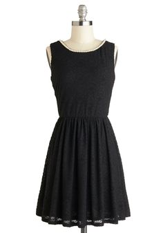 String of Twirls Dress. Its hard not to feel fancy in the perfect LBD, but this textured, floral dress boosts that spiffy sensation to one of spinning excitement, thanks to its golden neckline chain and faux pearls! #black #modcloth