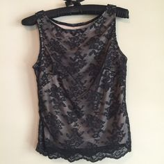 "Black lace top with nude slip A gorgeous top! Delicate black lace design, with a built in nude slip underneath. Love the scalloped lace hem! Great date night top. No signs of wear. 14"" across at bust, 21"" long. No tag to indicate the designer, can't remember where I bought. Bundle for a discount! Tops Tank Tops"