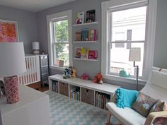 nursery.  I like this grey and orange trend.  I have an expedit bookcase in my craft room already, and I already have no doubt there will be one in my future nursery too.  Sturdy, inexpensive, and awesome storage.