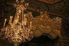 Hand carved gold gilt canopy over Marie Antoinette's bed
