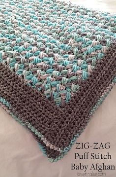 Learn all about the zig-zag puff stitch and work up this thick and plush baby blanket with the Crochet Puff Stitch Zig-Zag Babyghan.