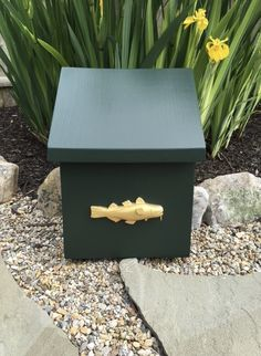 This custom made wooden mailbox with a hand carved wooden Golden Cod is cleanly designed to complement any seaside home.  Solid clear pine primed and painted in your choice of 3 colors – Essex Green, Black and Hale Navy Blue.