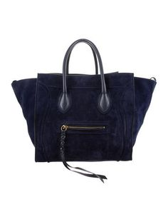 From the 2012 Collection by Phoebe Philo. Midnight blue suede Céline Medium Phantom tote with gold-tone hardware tonal leather trim, single zip pocket at front exterior, dual rolled top handles, tonal leather lining, single zip pocket at interior wall and pull-through closure at top. Includes dust bag. Shop authentic designer handbags by Céline at The RealReal.