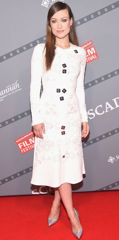 Olivia Wilde served up a picture-perfect look, selecting a pretty white embroidered Peter Pilotto dress that was slightly hardened, thanks to the sprinkling of silver hardware. Futuristic silver pumps completed her look.