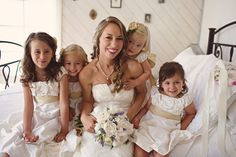 bride with all the flower girls