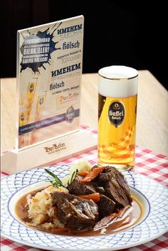 "In cologne we drink ""Kölsch"" and eat ""Schweinshaxe mit suure Kappes."" mean a knuckle of pork with sauerkraut."