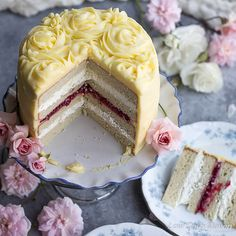 A pretty gluten-free birthday cake recipe with moist low carb cake and sugar free frosting, filled with sugar free raspberry jam and lemon whipped cream.