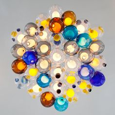 Canadian lighting brand Bocci and features this colourful chandelier by Omer Arbel