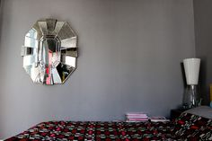 bedroom with vintage mirror and colorful blanket at stylist boris zbikowski's apartment