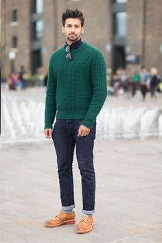 Shop this look on Lookastic: https://lookastic.com/men/looks/green-cable-sweater-navy-jeans-tan-leather-brogues/408 — Green Cable Sweater — Navy Jeans — Tan Leather Brogues