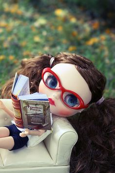Read. As often as possible. And red glasses are super cute on brunettes. ;)