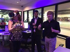 VR students showing off head mounted display to City of Tempe officials in UAT's New Technologies Lab.