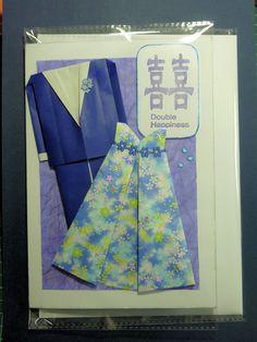 Handmade origami couples card.