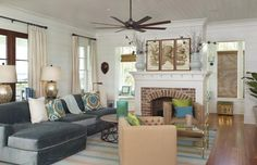 I love the coastal feel of this living room - right down to the octopus artwork! Greater Charleston SC Luxury Home Listings