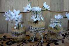 INSPIRATION: mason jars wrapped in burlap, coordinating fabric, and jute bows