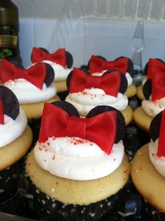 Minnie Mouse cupcakes- bows made of Starwberry Fruit Roll-Ups and Black Candy Melts for the ears