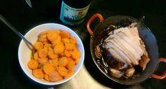 Varkenskroon met kruidenboter en uitjes naast sinaasappel worteltjes uit papillot