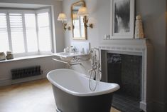 Timeless bathroom with stand alone bath tub monochrome, black and white plus chrome frame and lights. Love the artwork too. Photo from LivingEtc House Tours 2015 Timeless Bathroom, Modern Bathroom, Bath Tub, Clawfoot Bathtub, Shower Units, Interior Design Inspiration, House Tours, Monochrome, Color Pop