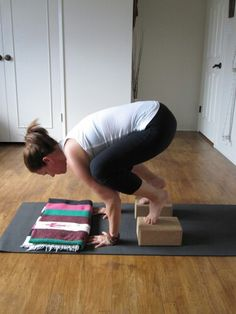Bakasana (Crow pose):: blocks help with the height and blanket provides cushion when you face plant!