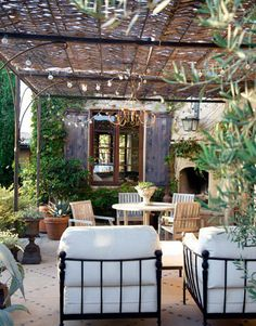 Great patio with arbor covering, hanging lights and chandelier. Very comfortable.