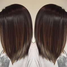 dark brown hair with subtle balayage Dark brown