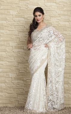 the traditional wear that symbolizes true Indian women beauty. The beautiful white saree to dress at party or outing with family. #saree #fashion #snapdeal