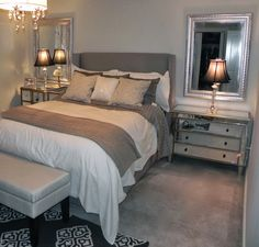 Gray and beige bedroom grey sheets. The paint is Benjamin Moore Wickham Gray.