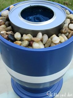 Instructions to make a mini patio table top fire pit in a plant container.  Looks like quick and easy back yard diy project.