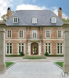Traditional Exterior by Bunny Williams Inc. and 3north in Richmond, Virginia, without brick, like the roof lines