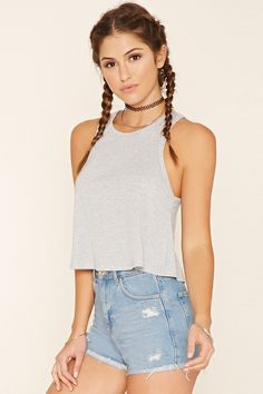 A sleeveless, flared crop top featuring a ribbed knit pattern, round neckline, and racerback.