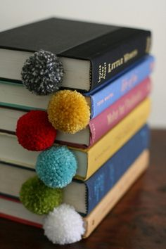 yarn ball bookmarks at design mom  Glue on little ears, googly eyes, etc. for animal lovers