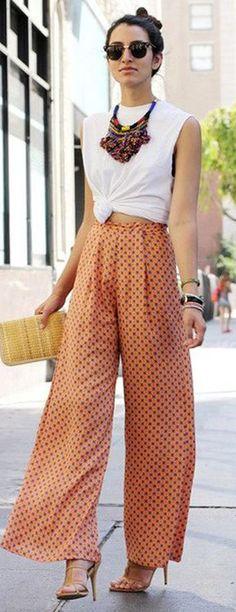 Tendência de verão: Calça Pantalona. Elas tem diversas versões, podendo ser super largas, médias, cintura alta, baixa, shape alfaiataria, estilo boho, de seda, etc, além de ser uma aposta fortíssima para essa nova temporada