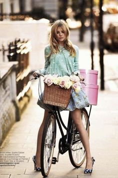 great lifestyle shot, flowers in basket, pretty colours, boxes on back of the bike, quirky post