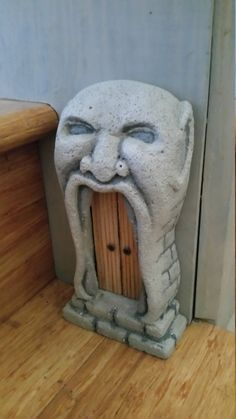 Hand crafted Goblin door to make your garden or home just a little more magical. With a tougher look than the elven doors, this is the front door any Goblin would be proud to call home. Sealed and suitable for indoor or outdoor use.  Each door is unique, hand carved from aerated concrete with a fixed timber door (Goblins always lock their doors) Repurposed jewellery brings each piece to life.  This door features a carved open maw of a Goblin. Knock on these double doors at your own peril…