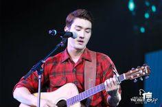 Choi Siwon. Love the plaid shirt.