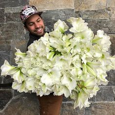 White Amaryllis - so pure and perfect! If you love our armloads, please feel free to repost them. I just ask that you tag me in your post instead of mentioning @theflowerhat in the post! That way I can see how far our flowers go!  #flowers #white #amaryllis #follow