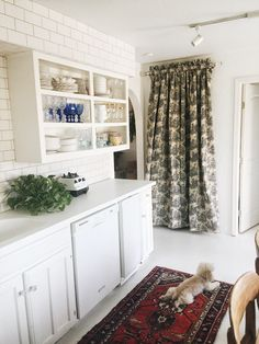 Atlantis Home interiors, Follow @atlantishome on Instagram, or check out the blog at www.atlantishome.com . . #kitchen #homeinteriors #homedecor #decor #curtains #dog #puppy #white #interiors #inpso #kitcheninspo #blog