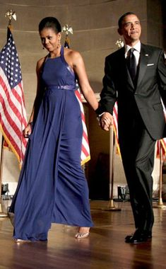 the FLOTUS looks breathtaking in a Reed Krakoff halter gown and strappy heels.