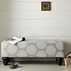 Chunky, and comfortable looking. I'd like one of these in my bedroom.  Good upholstery fabric choices as well.