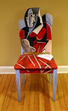 Esta silla pintada mejor rinde homenaje a la mujer de Picasso en pintura roja. La llamativa obra cubista de arte está pintada en acrílico mezclas y tonalidades de rojo, azul claro, gris y negro y características un asiento de tela de tapizado de pato. La parte trasera de la silla también se ha pintado en el estilo de Picasso. La silla entera tiene tres capas de poliuretano que puede ser una pieza funcional de los muebles. Mujer de Picasso en rojo pintado silla medidas 54″ H x 21″ W x 20″ D…