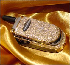 We would have loved this #gold flip phone about 10 years ago! #kmggold
