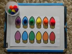 This is pretty neat for my 3 year old. With my 4 year old, I would write the colors on slips of paper and have him do both the color matching with the pom poms and the words.