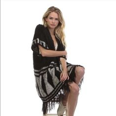 Black tribal sweater Amazing and boho black tribal sweater. One size. I have 5 available! Tea n Cup Sweaters