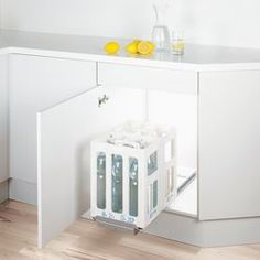 Base-mounted pull-out for gas canisters, machines or bottle crates. Day Work, Montage, Crates, Innovation, The Unit, Base, Canisters, Furniture, Bottle