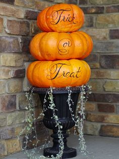 cute pumpkin topiary instead of trick or treat we can put names ,date,happily ever after, etc.