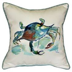 "Crab-print indoor/outdoor pillow with contrast piping.  Product: PillowConstruction Material: PolyesterColor: BlueFeatures:  Insert includedIndoor or outdoor use Dimensions: 18"" x 18"""