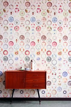 ODDY NEIGHBOURS  wallpaper —it's china plates! looks so English
