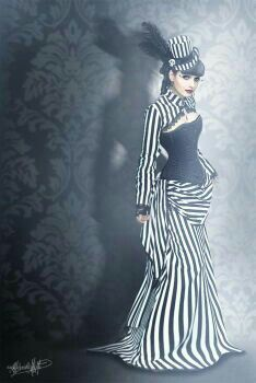 black and white striped steampunk wedding gown. I want that hat.