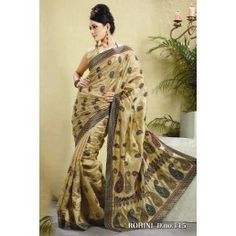 Beige color silk saree is with woven and embroidered motifs work