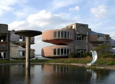 """Sanzhi District, Taiwan...Sanzhi District, Taiwan  The """"Sanzhi UFO houses"""" were a major development project for some pretty unusual-looking vacation homes, which was abandoned in 1978 before it could be completed. The site was demolished in 2008, and is now being redeveloped."""